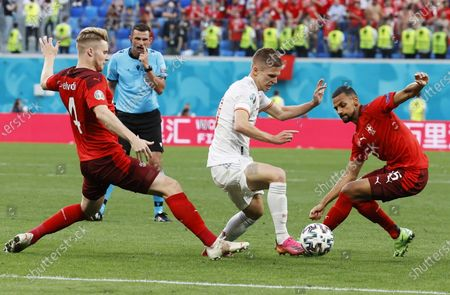 Stock Photo of Dani Olmo of Spain in action against Nico Elvedi (L) and Djibril Sow (R) of Switzerland during the UEFA EURO 2020 quarter final match between Switzerland and Spain in St.Petersburg, Russia, 02 July 2021.
