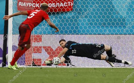 Stock Picture of Goalkeeper Unai Simon (R) of Spain saves the kick from Manuel Akanji of Switzerland during the penalty shoot-out in the UEFA EURO 2020 quarter final match between Switzerland and Spain in St.Petersburg, Russia, 02 July 2021.
