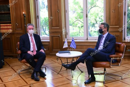 Mathias Cormann Secretary General of the Organization for Economic Co-operation and Development (left) and Greek Prime Minister Kyriakos Mitsotakis (right), during their meeting.