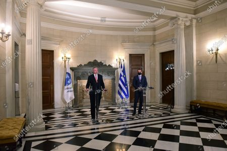 Mathias Cormann Secretary General of the Organization for Economic Co-operation and Development (left) and Greek Prime Minister Kyriakos Mitsotakis (right), during the statements.