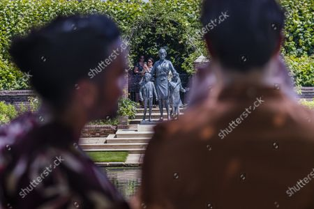 A steady flow of people come to see the statue on the first day it is open to the public and photograph it from every opening. A new statue of Diana, Princess of Wales, in the Sunken Garden of London's Kensington Palace. Commissioned by Diana's sons Prince William and Prince Harry in 2017, the statue was designed and executed by Ian Rank-Broadley and is in the redesigned garden (by Pip Morrison). It was unveiled on 1 July 2021 which would have been her 60th birthday.