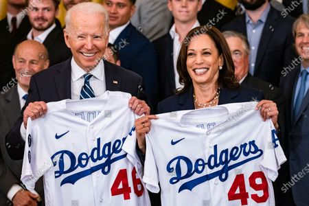 U.S. President Joe Biden and U.S. Vice President Kamala Harris hold up jersey's presented to them by the Los Angeles Dodgers during a ceremony in the East Room of the White House in Washington, D.C., U.S.,. Biden is hosting the Dodgers to celebrate their 2020 World Series victory, as the administration does more large, in-person events now that coronavirus vaccination rates have increased.