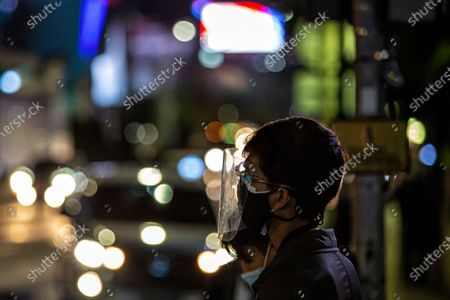 A man wear double protective face masks and face shield walk in business district on the last day before the emergency public activity restrictions (Emergency PPKM) in Jakarta, Indonesia on 2 July 2021. The Jakarta police would apply the emergency public activity restrictions (Emergency PPKM) beginning Saturday, July 3, 2021 following Indonesia's President Joko Widodo announced on Thursday to place 'emergency restrictions' on Java and Bali islands from July 3 to 21. All entry and exit points to and from Jakarta would be shut beginning 12 a.m. today. People are only allowed outside of their home for emergency and essential purposes. On Friday, Indonesia recorded 25,830 news COVID-19 cases in the past 24 hours, a fresh record of daily spike, bringing the total tally 2,228,938.