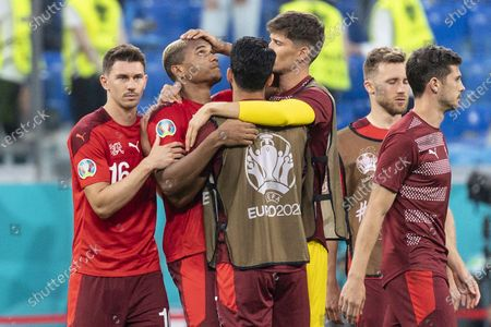The Swiss players comfort defender Manuel Akanji (2-L) after he missed a penalty during the UEFA EURO 2020 quarter final match between Switzerland and Spain in St.Petersburg, Russia, 02 July 2021.