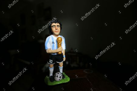 Fady Francis, 30-year-old journalist and artist, working on polymer clay  and creating 100 celebrities during the last year of covid 19 finshed 82 personalities like artists actors and football players. On July 2, 2021 in Cairo, Egypt. In picture: Diego Maradona Argentine football player.