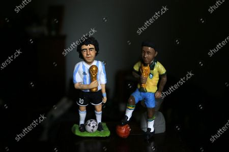 Fady Francis, 30-year-old journalist and artist, working on polymer clay  and creating 100 celebrities during the last year of covid 19 finshed 82 personalities like artists actors and football players. On July 2, 2021 in Cairo, Egypt. In picture: Diego Maradona Argentine football player and Pele Brazilian footballer.