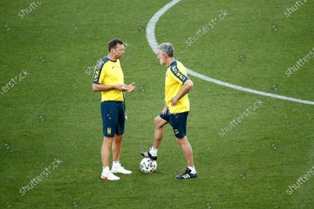 Stock Photo of Ukraine's manager Andriy Shevchenko, left, talks with his assistant Mauro Tassotti during a training session at the Olympic stadium in Rome, ahead of their Euro 2020 soccer championship quarterfinal match against England in Rome on Saturday