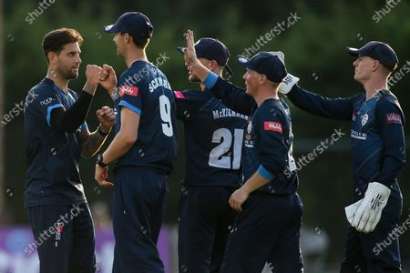 Jade Dernbach of Derbyshire Falcons celebrates with teammates after taking the wicket of Ben Cox of Worcestershire Rapids