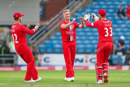 Stock Image of LancashireÕs Luke Wood celebrates with Dane Vilas and Rob Jones after taking the wicket of YorkshireÕs Mark Stoneman.