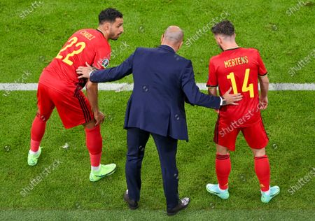 Stock Picture of Belgium's manager Roberto Martinez, centre, talks with substitutes Belgium's Nacer Chadli, left, and Dries Mertens as they prepare to join the game during the Euro 2020 soccer championship quarterfinal match between Belgium and Italy at the Allianz Arena in Munich, Germany