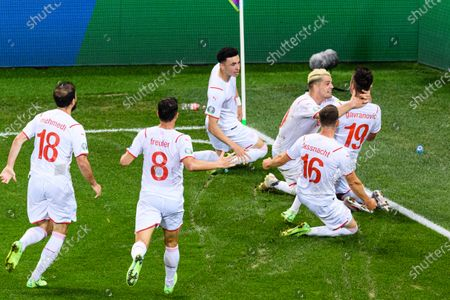 Mario Gavranovic of Switzerland (R) celebrating his goal with his teammates during the UEFA Euro 2020 Championship Round of 16 match between France and Switzerland at National Arena