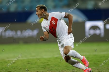 Peru's Miguel Trauco celebrates after scoring the winning goal and defeating Paraguay 4-3 in a penalty shootout during a Copa America quarterfinal soccer match at the Olimpico stadium in Goiania, Brazil