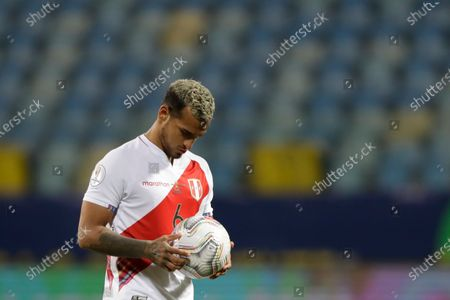 Peru's Miguel Trauco holds the ball on a penalty shootout against Paraguay during a Copa America quarterfinal soccer match at the Olimpico stadium in Goiania, Brazil, . Peru defeating Paraguay 4-3 in a penalty shootout