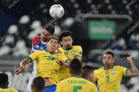 Roberto Firmino, Marquinhos of Brazil and Francisco Sierralta of Chile compete for a cross; Nilton Santos Stadium, Rio de Janeiro, Brazil; Copa America, Brazil versus Chile.