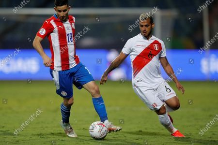 Stock Picture of Peru's Miguel Trauco (R) in action against Paraguay's Mathias Villasanti, during a match for the quarter-finals of the Copa America 2021 at the Pedro Ludovico Teixeira Olympic Stadium in Goiania, Brazil, 02 July 2021.