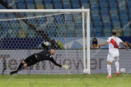 Peru's Miguel Trauco scores is side's winning goal in a penalty shootout during a Copa America quarterfinal soccer match at Olimpico stadium in Goiania, Brazil, . Peru qualified to the semifinals