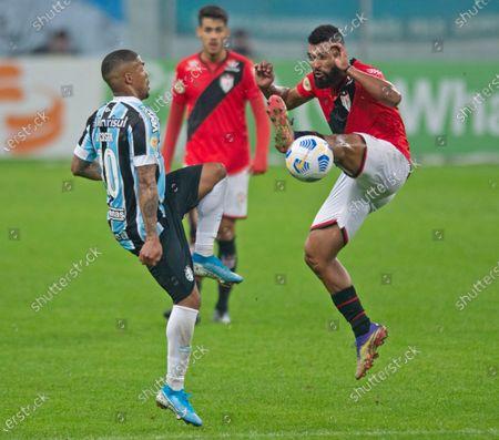 Stock Picture of Douglas Costa of Grêmio and Willian Maranhão of Atletico Goianiense; Arena do Gremio, Porto Alegre, Brazil; Brazilian Serie A, Gremio versus Atletico Goianiense.