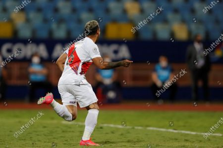 Peru's Miguel Trauco celebrates victory against Paraguay after scoring the last penalty in the shootout, at the conclusion of the Copa America 2021 quarter-finals soccer match between Peru and Paraguay at the Pedro Ludovico Teixeira Olympic Stadium in Goiania, Brazil, 02 July 2021.
