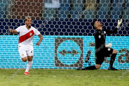 Stock Image of Miguel Trauco (L) of Peru celebrates a goal after kicking a penalty shot, at the conclusion of the Copa America 2021 quarter-finals soccer match between Peru and Paraguay at the Pedro Ludovico Teixeira Olympic Stadium in Goiania, Brazil, 02 July 2021.