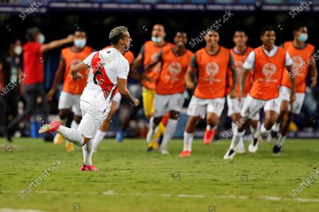 Stock Photo of Peru's Miguel Trauco celebrates victory against Paraguay after scoring the last penalty in the shootout, at the conclusion of the Copa America 2021 quarter-finals soccer match between Peru and Paraguay at the Pedro Ludovico Teixeira Olympic Stadium in Goiania, Brazil, 02 July 2021.