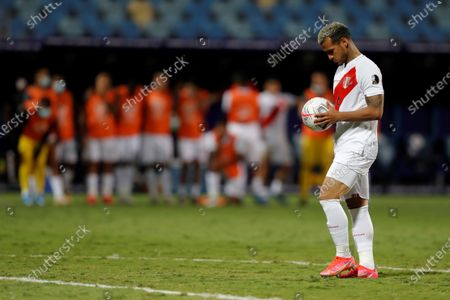 Peru's Miguel Trauco prepares to shoot the last penalty kick against Paraguay during the Copa America 2021 quarter-finals soccer match between Peru and Paraguay at the Pedro Ludovico Teixeira Olympic Stadium in Goiania, Brazil, 02 July 2021.