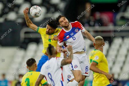 Brazil's Marquinhos, left, and Chile's Francisco Sierralta go for a header during a Copa America quarterfinal soccer match at the Nilton Santos stadium in Rio de Janeiro, Brazil