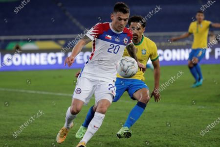 Brazil's Marquinhos (R) in action against Chile's Charles Aranguiz (L) during the Copa America 2021 quarterfinals soccer match between Brazil and Chile at the Nilton Santos Olympic Stadium in Rio de Janeiro, Brazil, 02 July 2021.