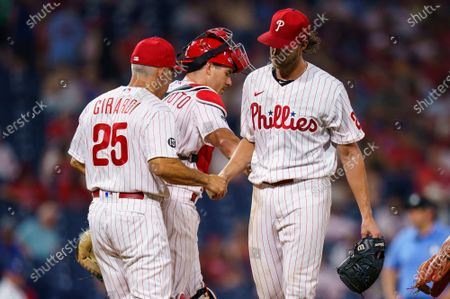 Philadelphia Phillies starting pitcher Aaron Nola, right, hands the ball off to manager Joe Girardi, left, as he is removed from the game during a baseball game against the Miami Marlins, in Philadelphia