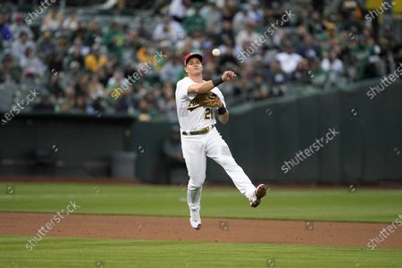 Oakland Athletics third baseman Matt Chapman (throws to first base for the out on a grounder by Boston Red Sox's Christian Vazquez during the fourth inning of a baseball game, in Oakland, Calif
