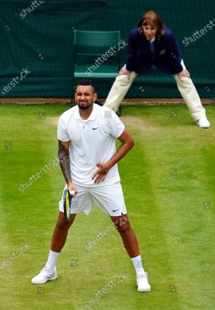Stock Picture of Nick Kyrgios struggles with his side during his third round match