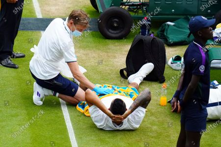 Stock Photo of Nick Kyrgios receives treatment during his third round match