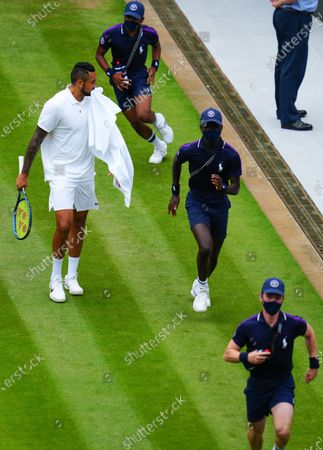 Nick Kyrgios is surprised by Ball Boys running on the court during his third round match