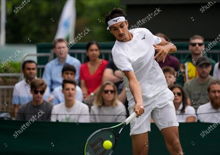 Italy's Lorenzo Sonego plays a return to Australia's James Duckworth during the men's singles third round match on day six of the Wimbledon Tennis Championships in London