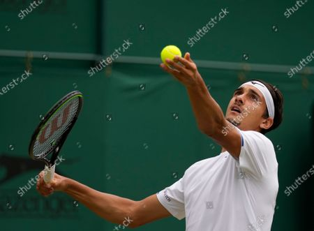 Italy's Lorenzo Sonego serves to Australia's James Duckworth during the men's singles third round match on day six of the Wimbledon Tennis Championships in London