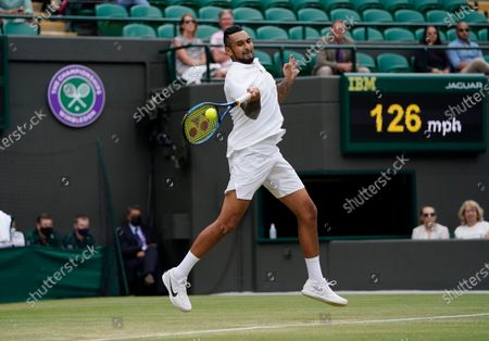 Australia's Nick Kyrgios plays a return to Canada's Felix Auger-Aliassime during the men's singles third round match on day six of the Wimbledon Tennis Championships in London