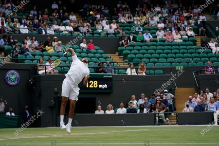 Australia's Nick Kyrgios serves during the men's singles third round match against Canada's Felix Auger-Aliassime on day six of the Wimbledon Tennis Championships in London