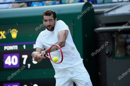 Croatia's Marin Cilic plays a return to Russia's Daniil Medvedev during the men's singles third round match on day six of the Wimbledon Tennis Championships in London