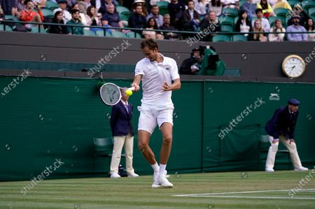 Russia's Daniil Medvedev plays a return to Croatia's Marin Cilic during the men's singles third round match on day six of the Wimbledon Tennis Championships in London