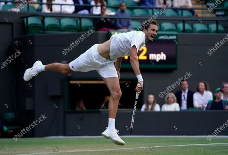 Russia's Daniil Medvedev serves to Croatia's Marin Cilic during the men's singles third round match on day six of the Wimbledon Tennis Championships in London
