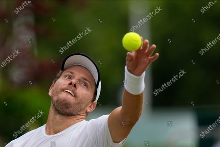 Australia's James Duckworth serves to Italy's Lorenzo Sonego during the men's singles third round match on day six of the Wimbledon Tennis Championships in London
