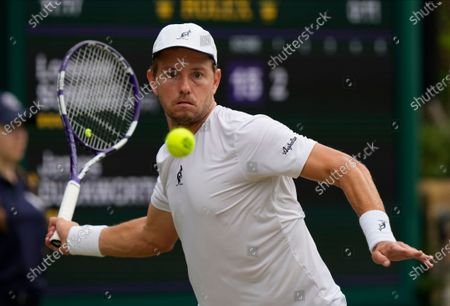 Australia's James Duckworth plays a return to Italy's Lorenzo Sonego during the men's singles third round match on day six of the Wimbledon Tennis Championships in London