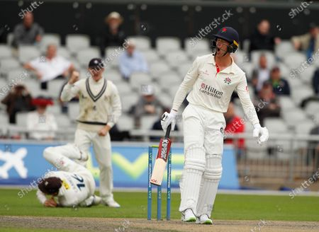 Keaton Jennings of Lancashire reacts after he is caught by Zak Crawley off the bowling of Matt Quinn; Emirates Old Trafford, Manchester, Lancashire, England; County Championship Cricket, Lancashire versus Kent, Day 2.