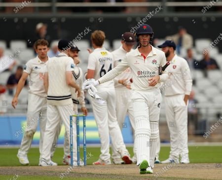 Keaton Jennings of Lancashire walks away after he is caught by Zak Crawley off the bowling of Matt Quinn; Emirates Old Trafford, Manchester, Lancashire, England; County Championship Cricket, Lancashire versus Kent, Day 2.