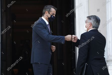 Stock Picture of (210703) - ATHENS, July 3, 2021 (Xinhua) - Greek Prime Minister Kyriakos Mitsotakis (L) welcomes Organization for Economic Co-operation and Development (OECD) Secretary-General Mathias Cormann in Athens, Greece, July 2, 2021. International cooperation is more important than ever to deal with the challenges of our time, Mathias Cormann said on Friday during a visit to Athens.