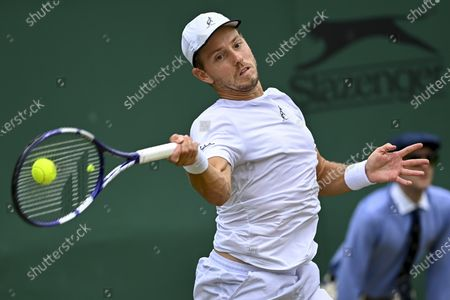 James Duckworth of Australia in action against Lorenzo Sonego of Italy during their third round match at the Wimbledon Championships in Wimbledon, Britain, 03 July 2021.