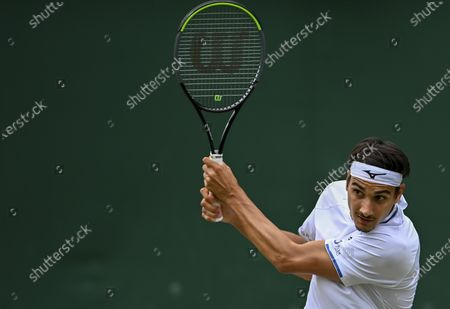 Stock Picture of Lorenzo Sonego of Italy in action against James Duckworth of Australia during their third round match at the Wimbledon Championships in Wimbledon, Britain, 03 July 2021.