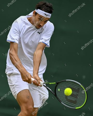Lorenzo Sonego of Italy in action against James Duckworth of Australia during their third round match at the Wimbledon Championships in Wimbledon, Britain, 03 July 2021.