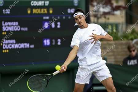 Stock Photo of Lorenzo Sonego of Italy in action against James Duckworth of Australia during their third round match at the Wimbledon Championships in Wimbledon, Britain, 03 July 2021.