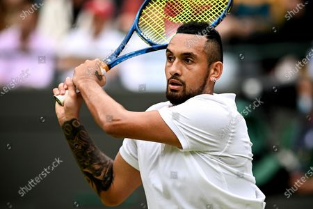 Nick Kyrgios of Australia hits a backhand during the 3rd round match against Felix Auger-Aliassime of Canada at the Wimbledon Championships, in Wimbledon, Britain, 03 July 2021.