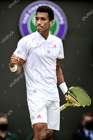 Felix Auger-Aliassime of Canada reacts during the 3rd round match against Nick Kyrgios of Australia at the Wimbledon Championships, in Wimbledon, Britain, 03 July 2021.